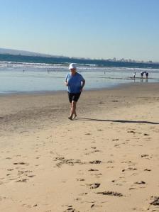 Grannie running on the beach